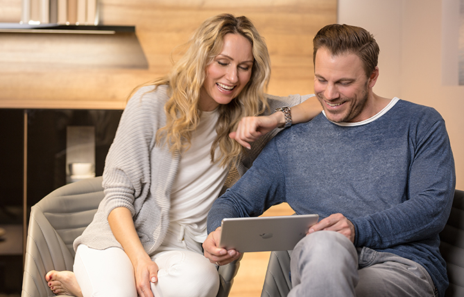 Couple planning their kitchen on a laptop