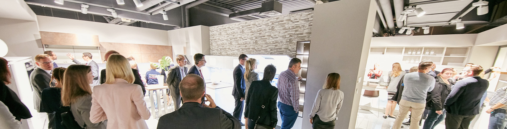 Visitors admire the kitchens at the nobilia in-house exhibition